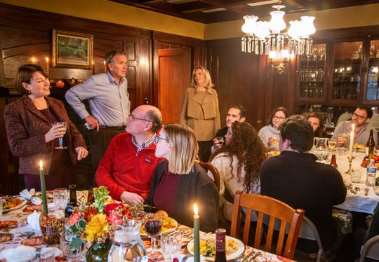 Sen. Amy Klobuchar D-Minn., gives a toast as she celebrates Thanksgiving at the home of her campaignÕs state chairwoman Andy McGuire Thursday, Nov. 28, 2019.
