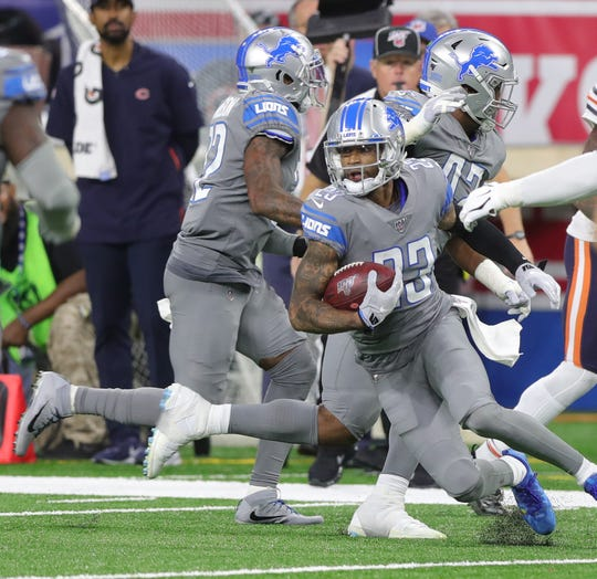Detroit Lions cornerback Darius Slay intercepts a pass by Chicago Bears quarterback Mitchell Trubisky during the second half Thursday, Nov. 28, 2019 at Ford Field.