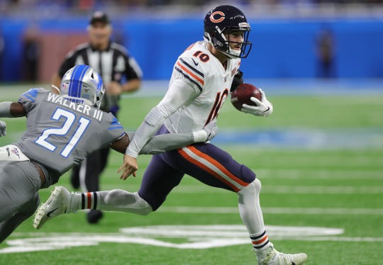 Chicago Bears quarterback Mitchell Trubisky is tackled by Detroit Lions defensive back Tracy Walker during the second half Thursday, Nov. 28, 2019 at Ford Field.