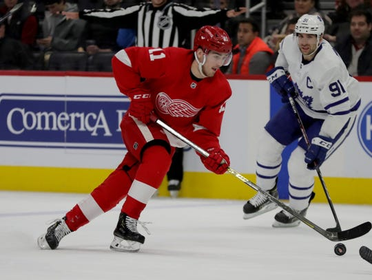 Detroit Red Wings right wing Filip Zadina is defended by Toronto Maple Leafs center John Tavares during the first period Wednesday, Nov. 27, 2019 at Little Caesars Arena.