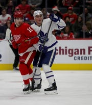 Detroit Red Wings right wing Filip Zadina is defended by Toronto Maple Leafs defenseman Tyson Barrie during the first period Wednesday, Nov. 27, 2019 at Little Caesars Arena.