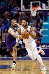 Late in the fourth quarter, Nicolas Batum fouls Derrick Rose in Charlotte on Wednesday.