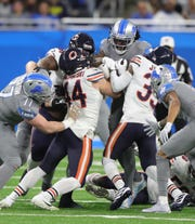 Detroit Lions running back Bo Scarbrough runs the ball against the Chicago Bears during the first half Thursday, Nov. 28, 2019 at Ford Field.