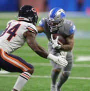 Chicago Bears linebacker Leonard Floyd  tackles Detroit Lions running back Ty Johnson during the second half Thursday, Nov. 28, 2019 at Ford Field.