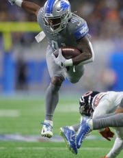 Detroit Lions running back J.D. McKissic runs the ball against the Chicago Bears during the first half Thursday, Nov. 28, 2019 at Ford Field.