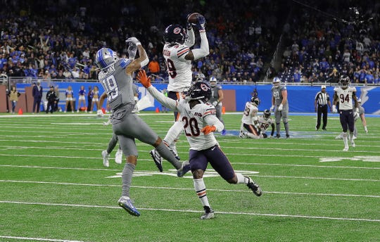 Chicago Bears safety Eddie Jackson (39) intercepts a pass intended for receiver Kenny Golladay on fourth down in the final minute of the Detroit Lions' 24-20 loss Thursday, Nov. 28, 2019 at Ford Field.