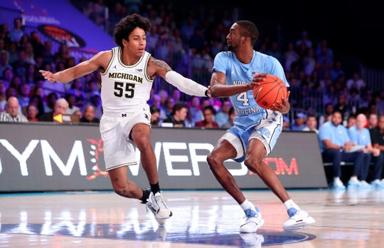 North Carolina guard Brandon Robinson looks to shoot as Michigan guard Eli Brooks defends during the first half in the Bahamas, Nov. 28, 2019.