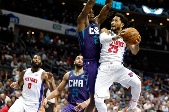 Detroit Pistons' Derrick Rose tries to find the basket against Charlotte Hornets' Bismack Biyombo during the second half in Charlotte, N.C., Wednesday, Nov. 27, 2019. The Hornets won 102-101.