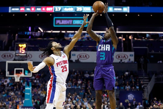 Pistons' Derrick Rose defends Hornets' Terry Rozier during the first half in Charlotte on Wednesday.