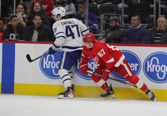 Detroit Red Wings left wing Taro Hirose defends Toronto Maple Leafs left wing Pierre Engvall during the second period Wednesday, Nov. 27, 2019 at Little Caesars Arena.