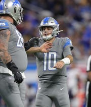 Detroit Lions quarterback David Blough celebrates a touchdown pass against the Chicago Bears during the first quarter Thursday, Nov. 28, 2019 at Ford Field.
