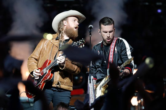 John Osborne, left, and T.J. Osborne of the Brothers Osborne musical duo perform during halftime Thursday at Ford Field.