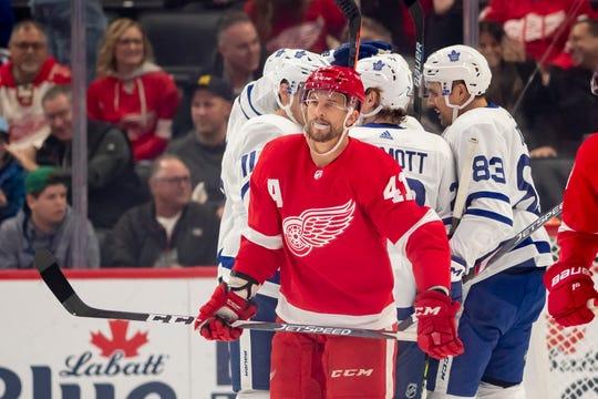 Detroit center Luke Glendening skates away after Toronto defenseman Travis Dermott scored a goal in the first period.