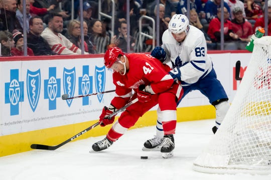 Detroit center Luke Glendening and Toronto defenseman Cody Ceci battle for the puck in the third period Wednesday night.