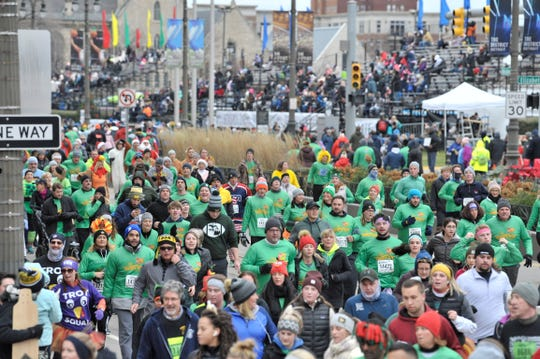 Turkey Trotters pound the pavement on Woodward Ave. before America's Thanksgiving Parade begins, Thursday morning, November 28, 2019. The parade, in its 93rd year and presented by Art Van, will feature more than 25 floats, including 7 new floats this year.