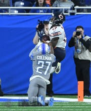 Chicago's Anthony Miller pulls in a long first-down reception to the 2-yard line over Detroit's Justin Coleman to set up the go-ahead touchdown in the fourth quarter Thursday.