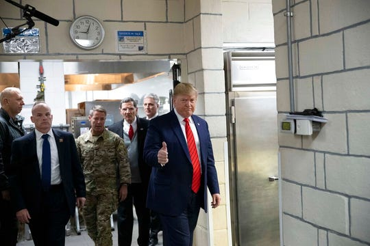 President Donald Trump gives thumbs up as he walks to serve dinner during a surprise Thanksgiving Day visit to the troops, Thursday, Nov. 28, 2019, at Bagram Air Field, Afghanistan.