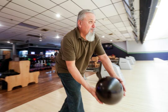Ricky Muniz bowls after talking about the impeachment hearings Friday, Nov. 22, 2019, in Mt. Pleasant, Wis.