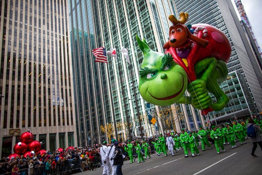 The Grinch balloon floats down Sixth Avenue during the Macy's Thanksgiving Day Parade, Thursday, Nov. 28, 2019, in New York.