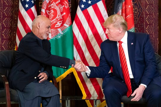 President Donald Trump shakes hands during a meeting with Afghan President Ashraf Ghani during a surprise Thanksgiving Day visit, Thursday, Nov. 28, 2019, at Bagram Air Field, Afghanistan.