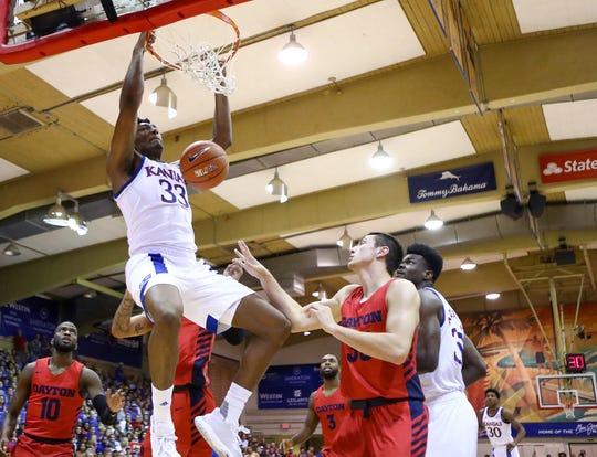 Kansas' David McCormack (33) dunks during the first half against Dayton.