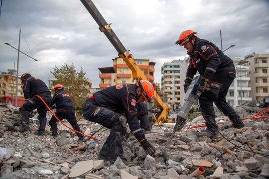 Turkish rescuers search at a collapsed building in Durres, western Albania, Thursday, Nov. 28, 2019. Hopes were fading Thursday of finding anyone else alive beneath the rubble of collapsed buildings in Albania two days after a deadly quake struck the country's Adriatic coast, with the death toll increasing to 41 after more bodies were pulled from the ruins.