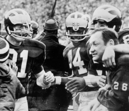 Coach Bo Schembechler celebrates with his Michigan players after the Wolverines upset No. 1 Ohio State 24-12 at Michigan Stadium in 1969.