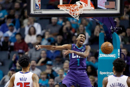 Charlotte Hornets' Malik Monk (1) celebrates his dunk as Detroit Pistons' Christian Wood (35) and Langston Galloway, right can only watch.