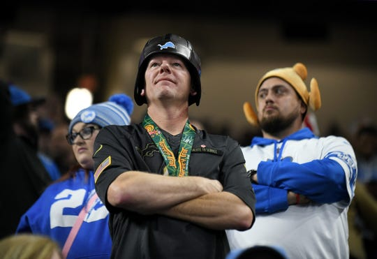 Lions fans look on late in the fourth quarter of Thursday's loss to the Bears.