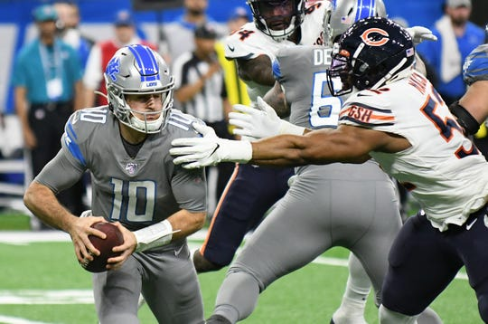 Lions quarterback David Blough evades a tackle attempt by Bears outside linebacker Khalil Mack.