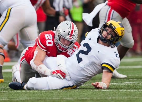 Quarterback Shea Patterson and Michigan found the sledding tough last season at Ohio State.