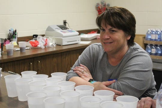 Cheryl Colston serves drinks at the 34th annual Vince Swindt Community Meal Thursday. Colston is the daughter of Swindt, who started the meal to help give the community a chance to spend Thanksgiving with community members.