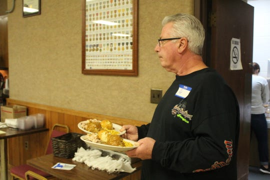 Pat Rocco delivers Thanksgiving meals Thursday at the VFW in Fremont.