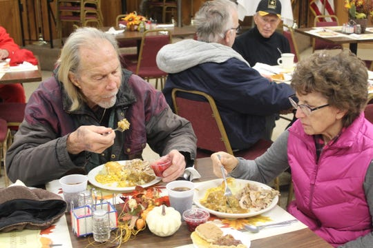 Bo and Vicky Borer, of Fremont, enjoy a free Thanksgiving meal at the Fremont VFW Post Thursday.