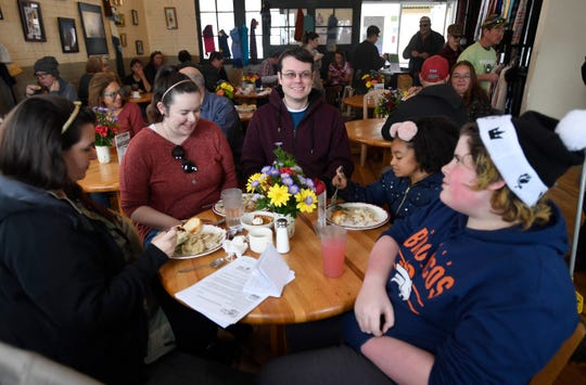 A family eats a Thanksgiving lunch at FoCo Cafe in Fort Collins, Colo. on Thursday, Nov. 28, 2019.