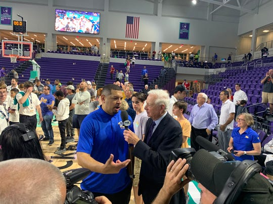Pittsburgh head coach Jeff Capel, left,  speaks with Bill Raftery, right, following the team's 72-59 victory over Northwestern.