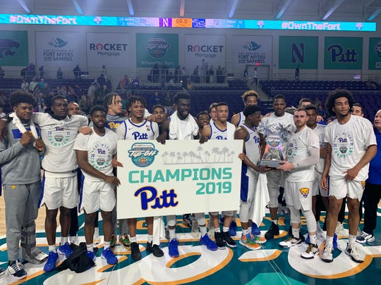 The Pittsburgh men's basketball team poses for a picture following their win against Northwestern in the Fort Myers Tip-Off Championship game.