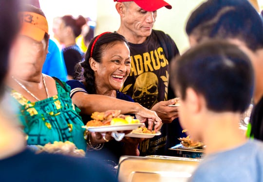 A smile beams from the face of Tamuning resident Judy Wang as she is served by volunteers during The Salvation Army's 23rd annual Thanksgiving Luncheon at the Chamorro Village main pavilion in Hagåtña on Thursday, Nov. 28, 2019.