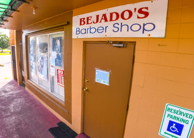A handwritten closed sign is posted on the front window of the Bejado's Barber Shop in Dededo on Thanksgiving Day, Nov. 28, 2019.