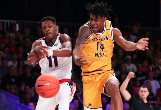Nov 27, 2019; Nassau, BHS; Gonzaga Bulldogs guard Joel Ayayi (11) and Southern Miss Golden Eagles forward Tyler Stevenson (14) go for the ball during the first half at Imperial Arena. Mandatory Credit: Kevin Jairaj-USA TODAY Sports