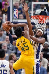 Indiana Pacers center Myles Turner (33) defends against Utah Jazz guard Donovan Mitchell (45) during the first half of an NBA basketball game in Indianapolis, Wednesday, Nov. 27, 2019.