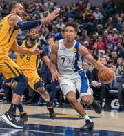 Nov 27, 2019; Indianapolis, IN, USA; Indiana Pacers guard Malcolm Brogdon (7) dribbles the ball while Utah Jazz center Rudy Gobert (27) defends in the first quarter at Bankers Life Fieldhouse.