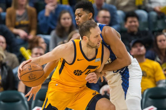 Nov 27, 2019; Indianapolis, IN, USA; Utah Jazz forward Bojan Bogdanovic (44) dribbles against Indiana Pacers guard Jeremy Lamb (26) in the second quarter at Bankers Life Fieldhouse.