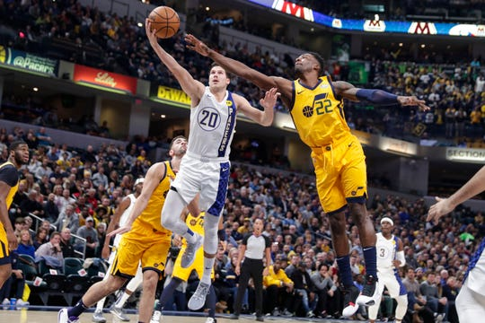 Indiana Pacers forward Doug McDermott (20) shoots in front of Utah Jazz forward Jeff Green (22) during the first half of an NBA basketball game in Indianapolis Wednesday, Nov. 27, 2019.