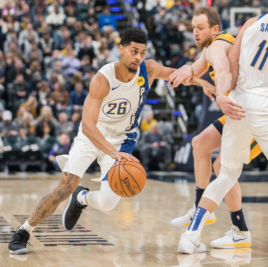 Nov 27, 2019; Indianapolis, IN, USA; Indiana Pacers guard Jeremy Lamb (26) dribbles the ball while Utah Jazz forward Bojan Bogdanovic (44) defends in the first quarter at Bankers Life Fieldhouse.