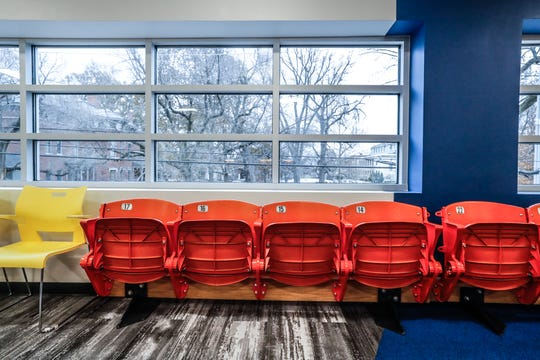 Bush Stadium seating from People For Urban Progress lines the wall in The Old North Side room overlooking the President Benjamin Harrison Home, at Guidon Design, 1221 N. Pennsylvania St., in Indianapolis, Wednesday, Nov. 27, 2019. The former FBI building, redesigned by Guidon, is Indiana's first LEED v4 Platinum building, awarded in 2019 for leadership in renewable energy and environmental design.