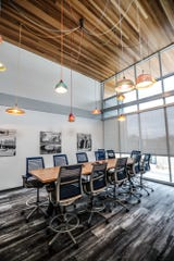 A conference room table made by Indianapolis company Purposeful Design, greets customers at Guidon Design, 1221 N. Pennsylvania St., in Indianapolis, Wednesday, Nov. 27, 2019. The former FBI building, redesigned by Guidon, is Indiana's first LEED v4 Platinum building, awarded in 2019 for leadership in renewable energy and environmental design.