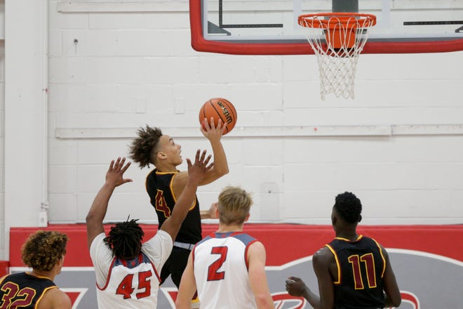 McCutcheon guard Dravyn Lawhorn (4) goes up for a layup during the third quarter of an IHSAA boys basketball game, Wednesday, Nov. 27, 2019 in West Lafayette. West Lafayette won, 43-29.