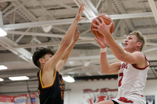 West Lafayette guard Tyler Boyle (2) goes up for a layup during the third quarter of an IHSAA boys basketball game, Wednesday, Nov. 27, 2019 in West Lafayette. West Lafayette won, 43-29.