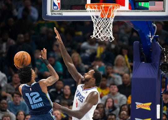 Memphis Grizzlies guard Ja Morant (12) shoots over Los Angeles Clippers forward JaMychal Green (4) during a game at the FedExForum in Memphis, Tenn., on Wednesday, Nov. 27 2019.